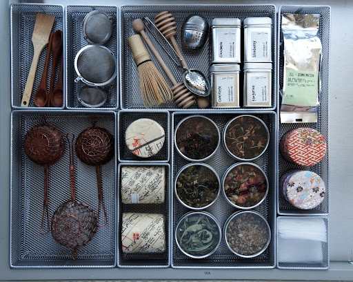 Instead of simply tossing tea packets and strainers in a drawer, keep them organized with a compartmentalized space like this one.