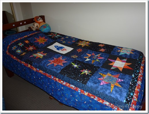 wonky star space quilt on bed