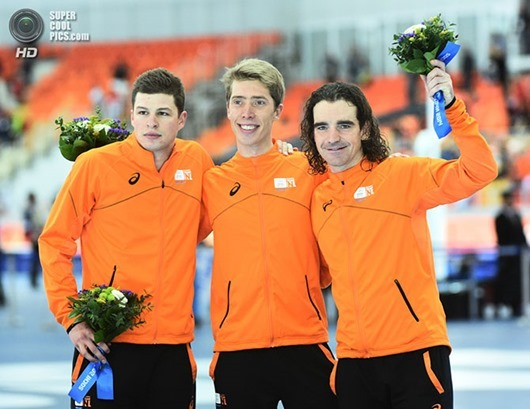 Feb 18, 2014; Sochi, RUSSIA;Silver medalist Sven Kramer, left, gold medalist Jorrit Bergsma, center and bronze medalist Bob de Jong, all of the Netherlands celebrate their medal sweep in the speed skating men's 10000m during the Sochi 2014 Olympic Winter Games at Adler Arena Skating Center. Mandatory Credit: Robert Hanashiro-USA TODAY Sports