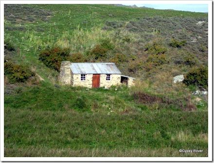 MacTavish's Hut, a restored gold miners hut on the Ida Valley road.