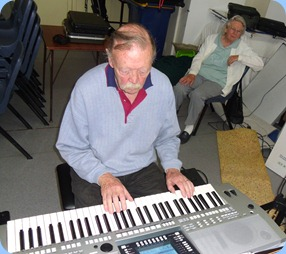 Colin Crann playing his Yamaha PSR-710 whilst Yvonne, his wife, watches on intently