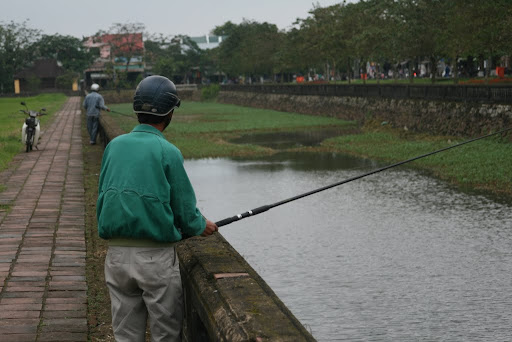 Locals fishing in the Citadel's moat.