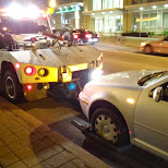 car getting towed on spadina in toronto in Toronto, Ontario, Canada