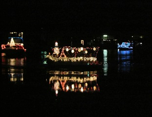 Lots of Christmas decorated boats float by