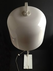 Floor lamp with an acrylic shade and marble base