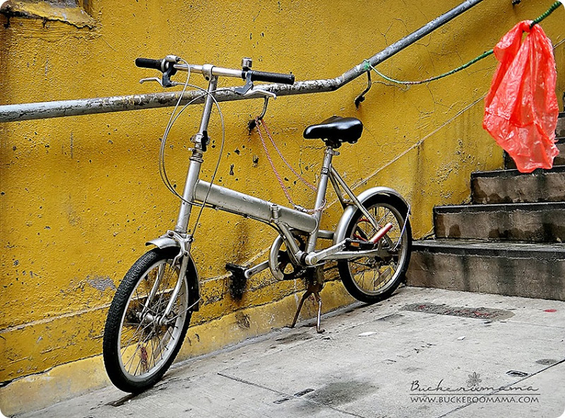 Bicycle-against-yellow-wall