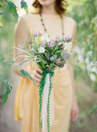 Kate mixed the fritillaria with sword fern and variegated wild grass blades. Layers of vintage trim lent the bundle a bit of romance.