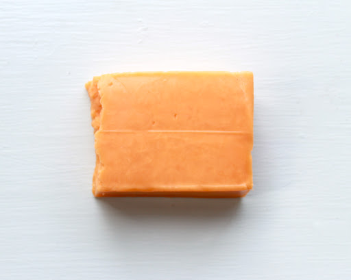A brick of Kraft cheddar cheese