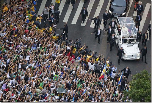 Pope Francis greets a crowd of the faithful from his Popemobile in downtown Rio de Janeiro, July 22 - Copy