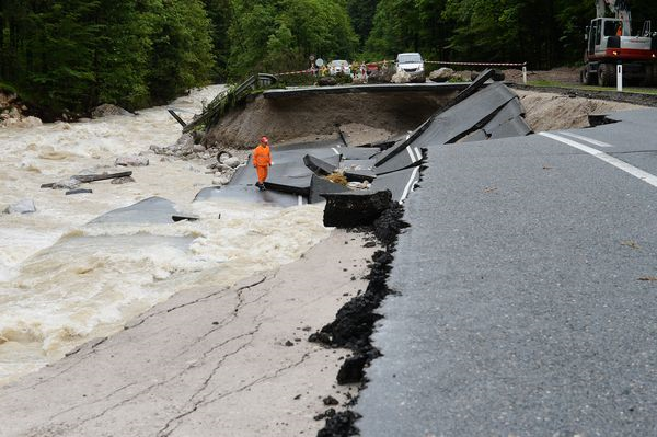 In Austria, roads were severely damaged after heavy rainfall caused flooding along rivers and lakes, 6 June 2013. The Austrian meteorological service reported that two months' worth of rain fell in the country in the last two days, according to the BBC, significantly straining the local infrastructure. Photo: Kerstin Joensson / AP
