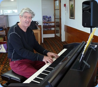Ian Jackoson giving the Clavinova a warm-up.  Photo courtesy of Dennis Lyons.