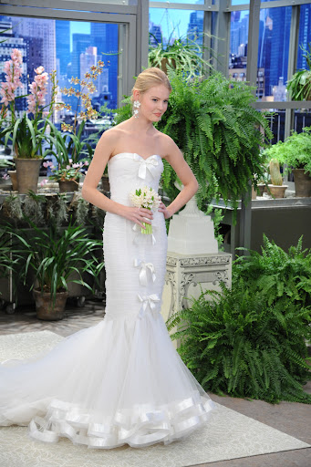 This ruched tulle strapless mermaid gown with satin ribbon trim is so sweet.