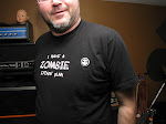 "Steve's T-Shirt is a cipher.  Rearrange the letters and you get the Organical Credo:    ""Mechanize Above Papalise""       Oh yes, the machine rules all."