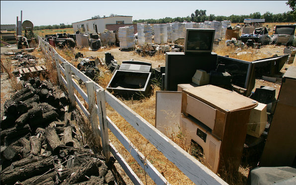 Flat-screen technology has made monitors and televisions like the ones seen here in Porterville, California, obsolete, crushing the demand for the recycled tube glass in them and creating stockpiles of the useless material across the country. Photo: Gary Kazanjian for The New York Times