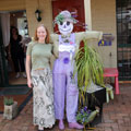 Bronwen with a scarecrow at Tamborine Mountain Scarecrow Festival