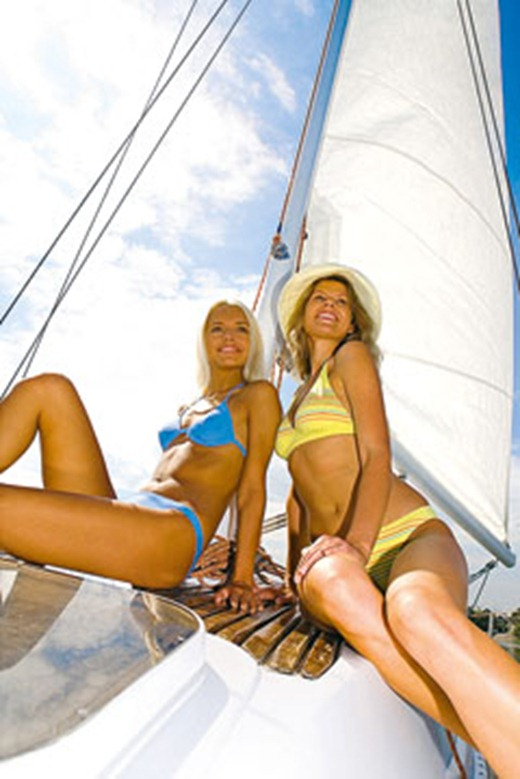 Portrait of two attractive women relaxing in cruise