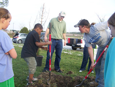 Trees Forever consultant Dustin Hendrix (center) instructs 4-H Horse and Pony Club members on the proper way to dig a hole for trees.  Photo courtesy:  Washington County Extension.