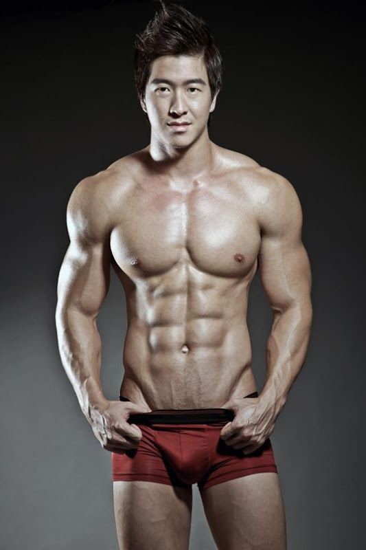 Jason Chee in maroon trunks