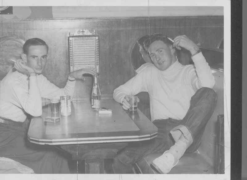 Edgar Sandifer (left) and Dirk at a restaurant booth. Circa 1950s.