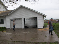 The garage door has been blown in on the house Lowell Unruh's turkey farm in the 1100 block of Franklin Avenue in Henry County