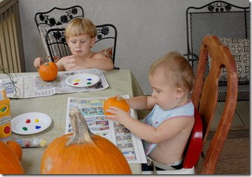 boys painting pumpkins