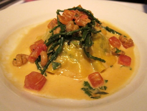 Crab ravioli with samphire, brown shrimps, fondue of leeks and bisque sauce