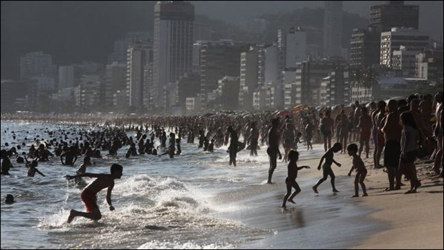 Crowds jam Ipanema Beach during a summer heat wave as December 2013 gave way to January 2014 in Rio de Janeiro, Brazil. Temperatures climbed to 104 in the city with a heat index measured at 122 degrees. Photo: Mario Tama / Getty Images