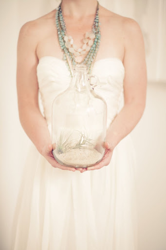 Glass jugs filled with sand and air plants decorated the space.