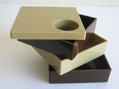 Brown and tan plastic desktop organizer cube