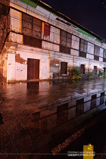 Ancestral House Reflection on Wet Pavement