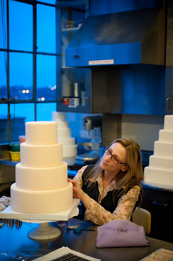 Here, Wendy is in one of the test kitchens piping cakes. This was one of the stops on the tour of our office.