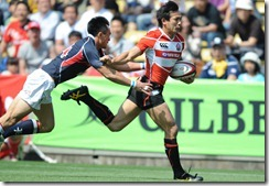 2012-JPN wing Hirotoki Onozawa holds off HKG's Yiu Kam Shing to score his 51th test try, 4th best all time