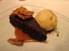 Chocolate and almond torte with honeycomb ice cream and caramel sauce