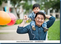 man carrying a boy on his shoulders