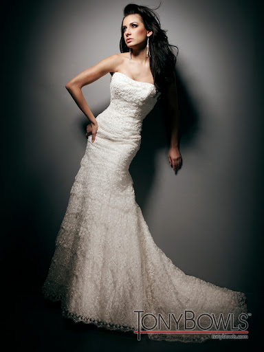 The layered lace on this Tony Bowls gown creates soft, elegant lines.