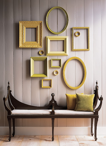 salon-style wall with blank frames.