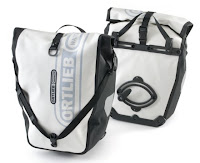 Ortlieb bags will keep all the stuff you need to carry bone-dry as well. They're the best.