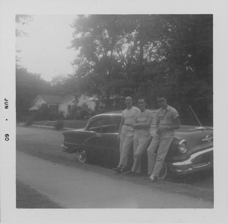 Three of Edgar Sandifer's friends waiting by a car. June 1960.