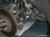 Old control arm , shows the bad bushing and also bad tie rod