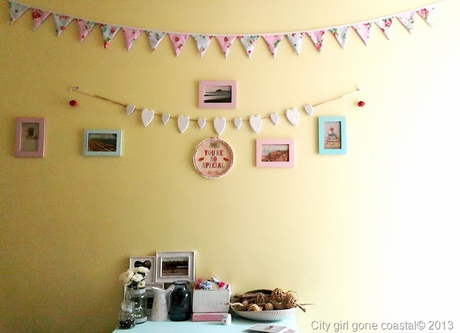 living room, focus wall, decoration, bunting, frames