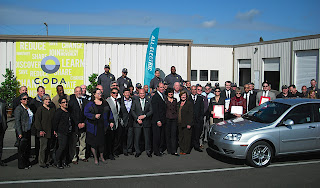 "'Never before has the case for what we do been clearer,"" said Coda Automotive chairman Mac Heller (tall, center) as the first vehicle rolled out of the final assembly facility in Benicia, Calif. on March 12."