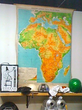 Reclaimed classroom maps hung in the roasteria show top coffee-growing regions.