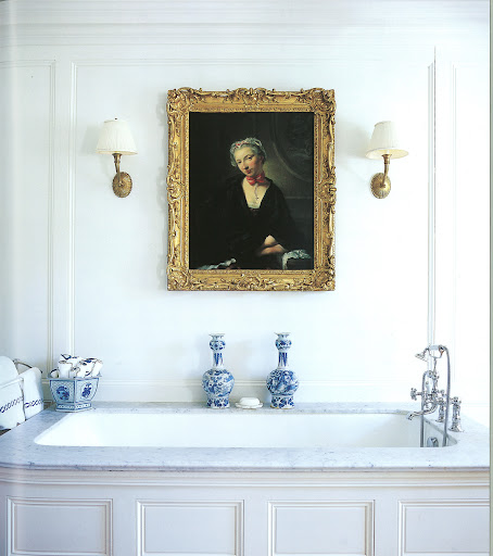 The portrait above the soaking tub has a similar effect. The bathroom blends in with the other rooms in the house.