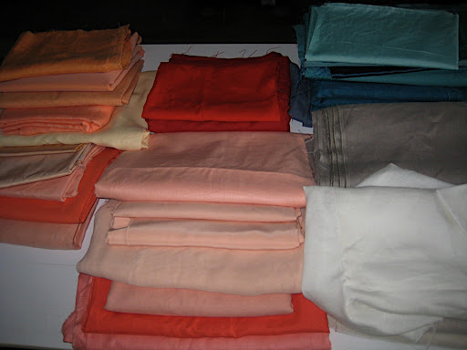Our fabrics, arranged in color order on our shoot.