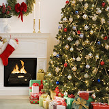 Christmas tree with presents and fireplace with stockings --- Image by  Royalty-Free/Corbis