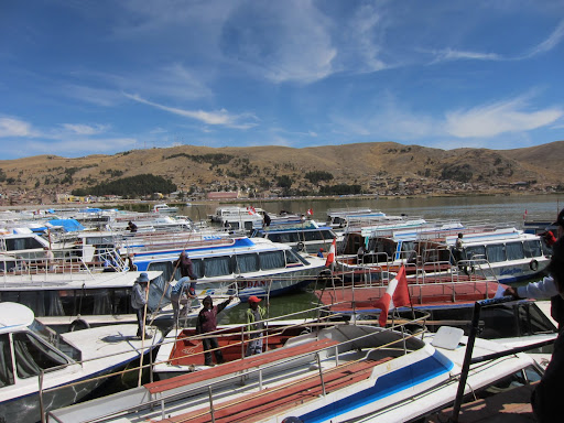 Boats in the port of Puno, ready to depart to the floating islands and other places around Lake Tititcaca