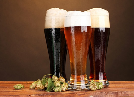 three glasses with different beers and hop