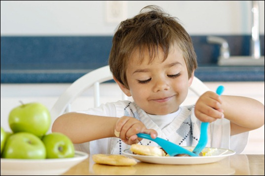 toddler-boy-eating-with-utensils