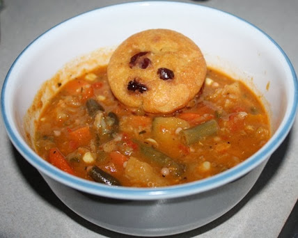 soup with few roasted vegetables served with muffin