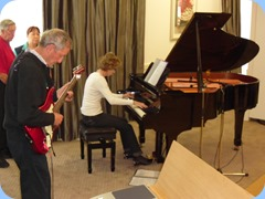 Denise Gunson playing the Yamaha Grand Piano very professionally with Brian Gunson accompanying on his electric guitar